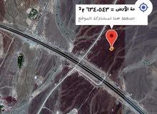 ارض للبيع 697م على الخط السريع ولاية ينقل