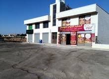 مجمع بناء جديد للإيجار  ام البساتين- على شارعين مغارض  بمساحات متنوعه
