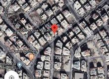 ارض على 3 شوارع تصلح لمول بالجبيهة مساحة 11 دونم