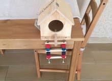 منزل طيور خشبي