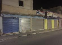 قطعه ارض بيها محلات في شارع الخطوط الصابري