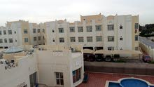 Nice fully furnished   2 bedrooms  + 3 bathrooms + gym + swimming pool  in a compound in Abu hamour