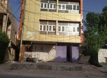 بناية 140 متر كربلاء حي رمضان 4 شقق + بيت + محلات 2 وارد شهري 1,400