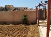 بيت للبيع 4 واجهات حجر على شارعين سوبر ديلكس الزرقاء الجديده جبل المغير
