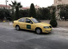 Automatic Yellow Nissan 2010 for rent
