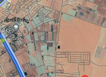 للبيع ارض 692 م شارعين في الطنيب ملاصق للنقابه
