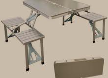 طاولة + 4 كراسي تتسفط من الالمنيوم القوي والخفيف ويتحمل الأوزان مع شنطه