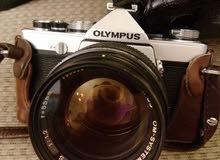 كاميرا OLYMPUS OM-1 مع مجموعة من العدسات والملحقات