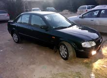 Green Mazda 323 2000 for sale