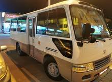 Toyota bus coaster for hire للايجار باص كوستر تويوتا