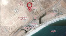 ارض سكني تجاري مساحه 28 الف بسلطنه عمان مقابل المنطقه الحره وميناء صلاله