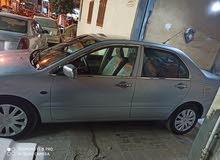 سيارة لانسر 2012 فابريكة بالكامل للبيع