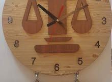 ساعات جدارية خشبية
