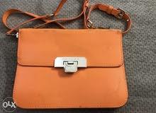 Charles and Keith orange purse for sale original سعر قابل للنقاش