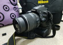 Nikon D5100 Dslr Camra  weth 18-55mm lens + battrygreap accsess
