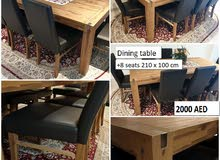Dining table with 8 leather chairs from homes r us