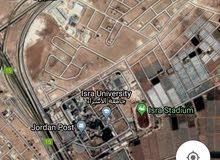 ارض في الطنيب 600م قرب جامعة الاسراء حوض العيادات للسكن أو الاستثمار