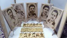 ميداليات منحوته من الخشب علئ حسب الصور ارسل الصوره الذي تريد وسوف نصنع لك ميدالي