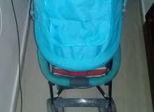 عربة اطفال جديدة