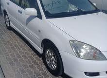 سيارة متسوبيشي لانسر بحاله ممتازه جدا موديل 2004