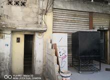 طابق أرضي في مخيم الحسين للبيع