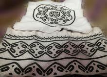 كميم عمانيه خياطة يد باللون الاسود .واللون الرصاصي
