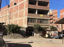 عماره للبيع بالكامل خمس ادوار بها خمس شقق اول شقه متشطبه علي شارع عرضه 25م