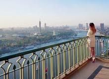 شقة فندقية بكورنيش النيل بالبرج السكني بفندق four seasons nile plaza