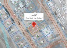 للبيع أرض في صناعية الرسيل/ الجفنين مساحتها 1013 م مسورة بالكامل بسور 3 أمتار و
