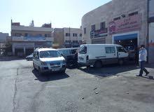 مركز محمد العبوشي لصيانة جميع السيارات
