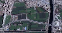 للجاديين فقط فدان ارض مباني تصلح لعمل ابراج ومشاريع مختلفه قريبه من جامعة السلاب