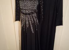 فستان سهرة طويل لون اسد وعباي سوده جديده