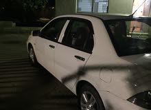 For sale Mitsubishi Lancer car in Mafraq