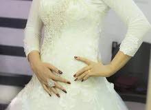 فستان زفاف لبسه واحده