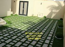 تنسيق حدائق عشب صناعي عشب جداري