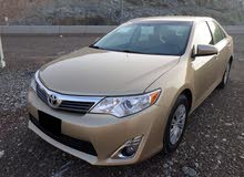 تويوتا كامري-لون ذهبي-م 2012-4 سلندر-وارد أمريكا-أوراق جمارك-بحالةممتازة-ماشية 90.883