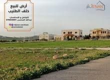 ارض للبيع قرب شارع عمان التنموي صدر ابو دبوس