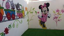 رسام علي الجدران