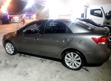Kia Forte 2009 For Rent - Brown color