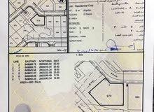 ارض للبيع في العامرات 8/1 قريبه من محطة نفط عمان وانت نازل من العقبه على اليسار