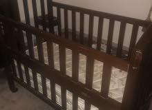 سرير أطفال خشب بعجلات