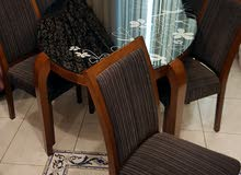 Dining table with 6 chairs from al ghanem just like new
