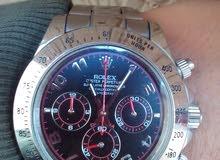 ساعة رولكس (ديتونا) اخذتها من حولي 5 أشهر ، نضيفة وكل العقارب الداخلية تشتغل