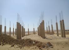 ارض للبيع جاهزة للبناء بها كهرباء على الطريق الدائري الجديد بعد 15مايو بعشر دقيق