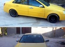ابحث عن سياره اوبترا موديل 2007 او 2008 اللون اصفر رقم بغداد او بابل