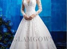 فستان زفاف مع الطرحة والجيبونه وارد كندا غير ملبوس.