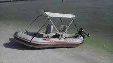قارب ربل مطاط جديد مع مكينة بترول جديدة