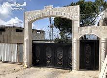 مزرعة وبيتين و 7 محلات للبيع من المالك مباشرة بدون وسيط في الأردن/ عجلون