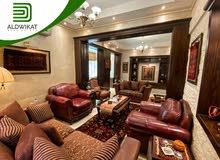 شقة شبه ارضية مفروشة للبيع في الجبيهة مساحة البناء 185 م - مساحة الترس 130م - الحديقة 20 م