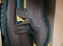 Caterpillar shoes ... brown color .. size  44... used once